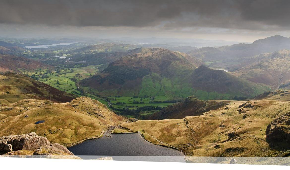 Image of mountains and a lake overlooking Stickle tarn and Langdale Valley.